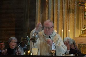 Pastor Tom Buitendijk wih choir in background.