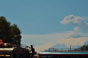 at the Antigua bus terminal, active volcano on horizon